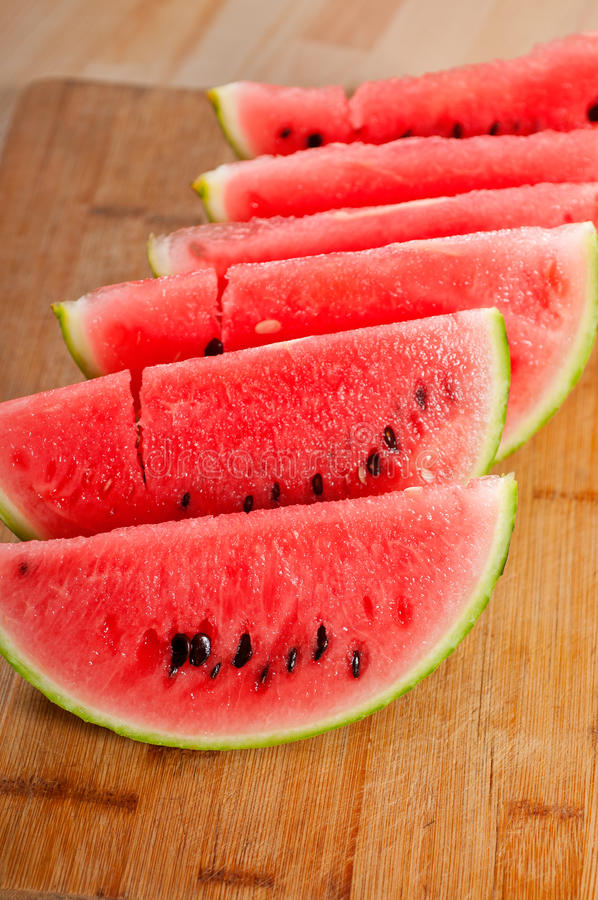 Fresh watermelon on a wood table royalty free stock photography
