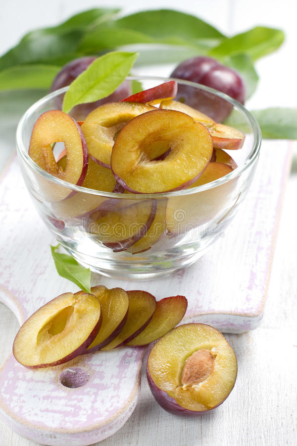 Fresh Wet Plums With Leaves In The Bowl On The Vin Royalty Free Stock Photo