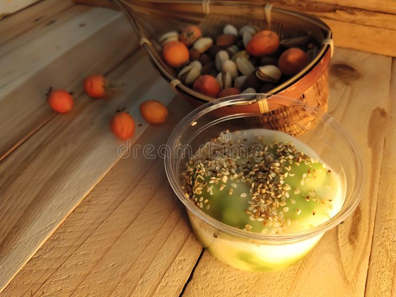 Fresh wet sweets topped with coconut milk,sprinkled with roasted white sesame seeds Thai desserts. Milksprinkled royalty free stock photo