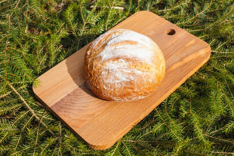 Fresh white bread on a cutting board against royalty free stock photo