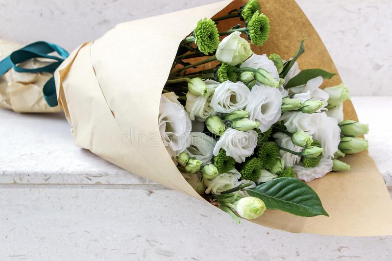 White flowers wrapped in paper stock photo image of closeup download white flowers wrapped in paper stock photo image of closeup flower 105487992 mightylinksfo Gallery