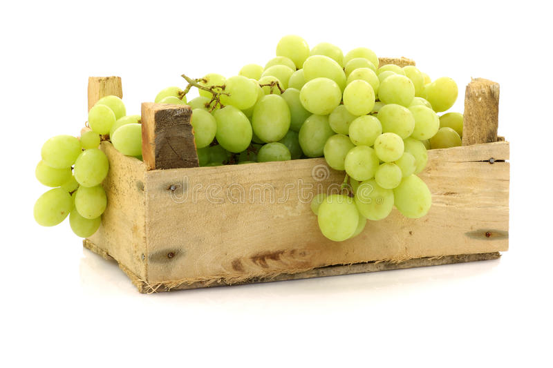 Fresh white grapes in a wooden box stock photos