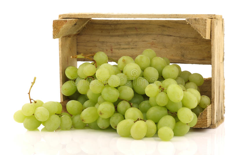 Fresh white grapes in a wooden box royalty free stock photography