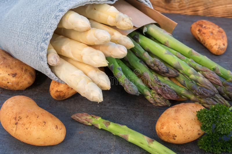 Fresh asparagus with new potatoes royalty free stock photo