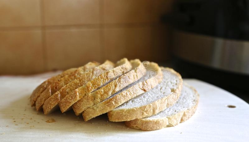 Fresh white without yeast  Mediterranean  bread is cut exactly by pieces for food and sandwiches. White bread is cut exactly on pieces a side view stock images