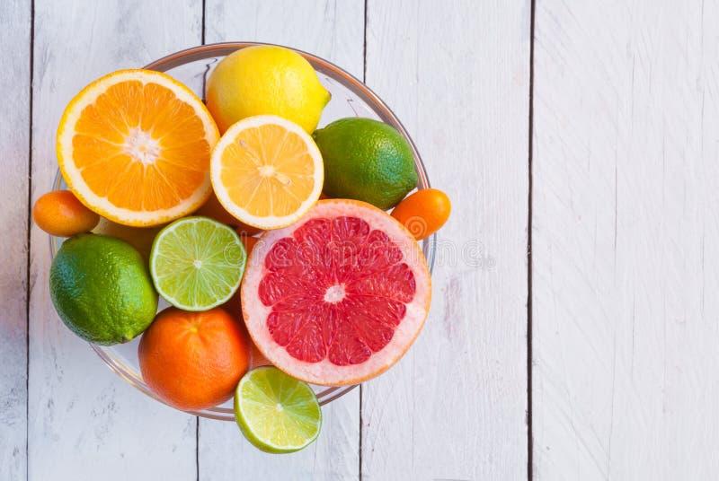 Fresh citrus fruits orange, lemon, grapefruit, mandarin, lime with leaves royalty free stock images
