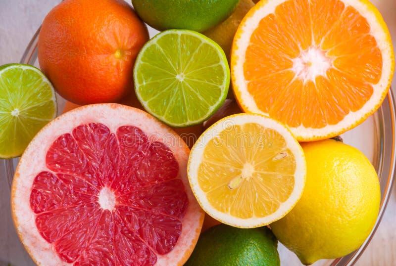 Fresh citrus fruits orange, lemon, grapefruit, mandarin, lime with leaves royalty free stock photos
