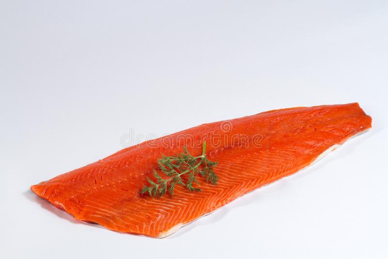 Fresh Whole Salmon Fillet on White Background with Dill royalty free stock image