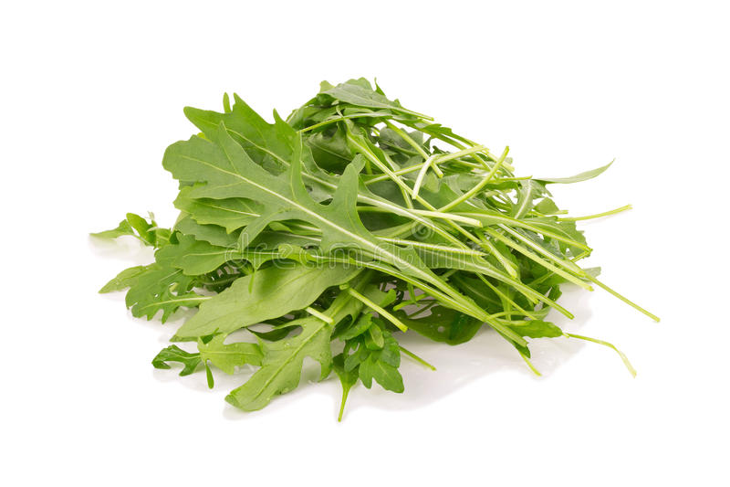 Fresh wild rocket rucola leaves on white background.  royalty free stock image