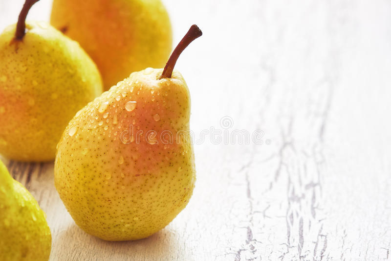 Fresh williams pears. Bartlett pear on white rustic background. Copy space stock photo