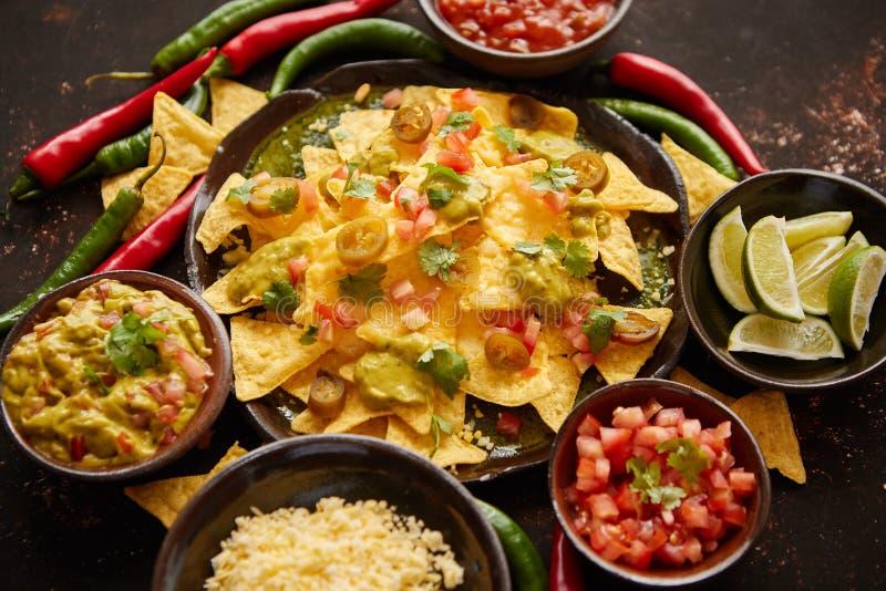 Fresh yellow corn nacho chips on ceramic plate stock photos