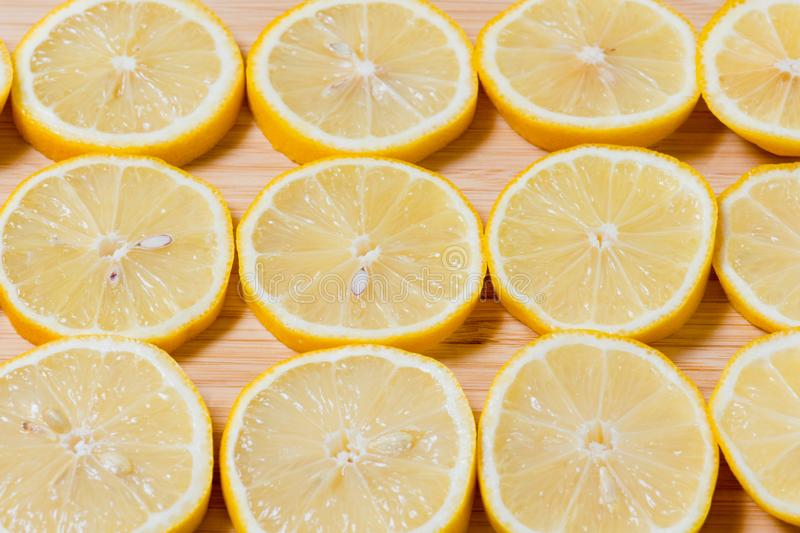 Fresh yellow lemons slices on a wooden background.. sweet lime, vitamin c. Lemon slice. Fresh yellow lemons on a wooden background.. sweet lime, vitamin c royalty free stock photography