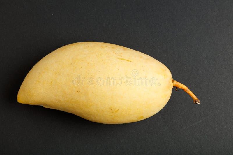 Fresh yellow mango. With black background, close up royalty free stock photo