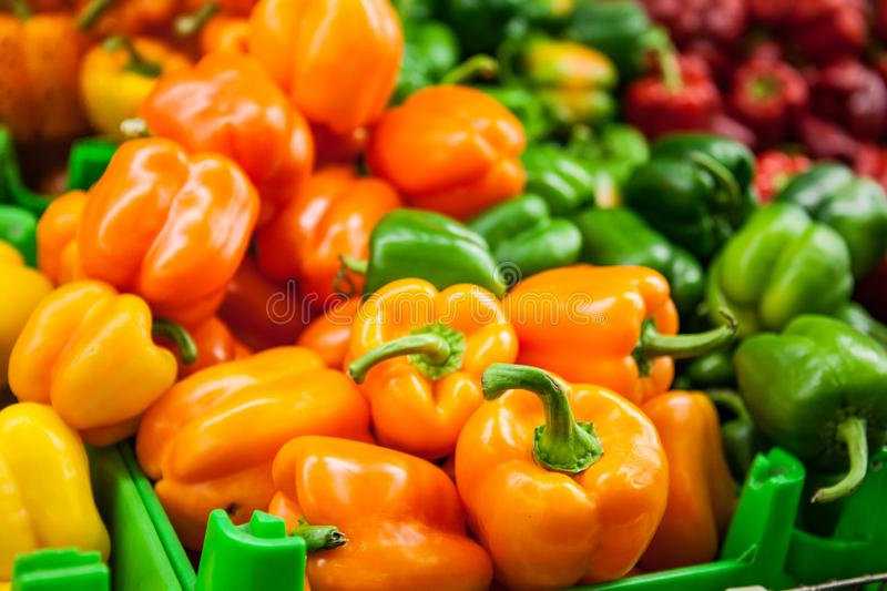 Fresh Yellow, orange, greeen and red peppers at the market royalty free stock photos
