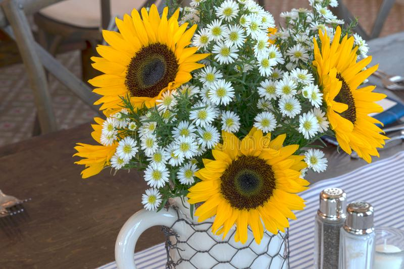 Fresh yellow sunflowers and white daisies stock image