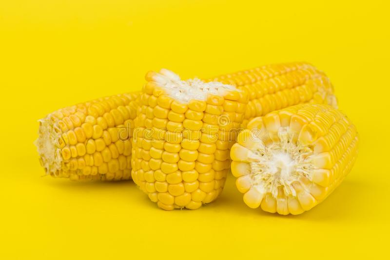Fresh yellow sweet corn on yellow. Background stock image