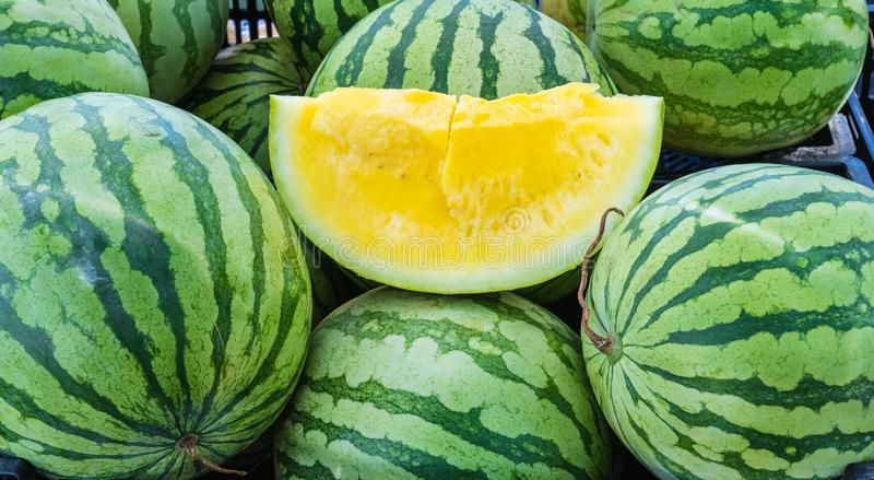 Fresh yellow water melon cut open royalty free stock photography