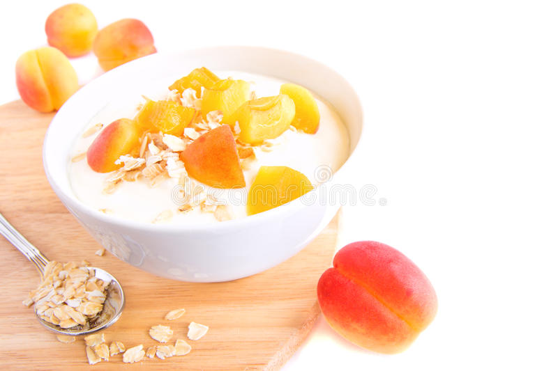 Fresh yogurt with apricots and cereal royalty free stock images