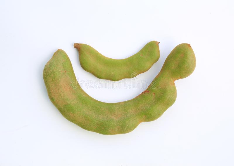 Fresh young green Tamarind Tamarindus indica isolated on white background royalty free stock images