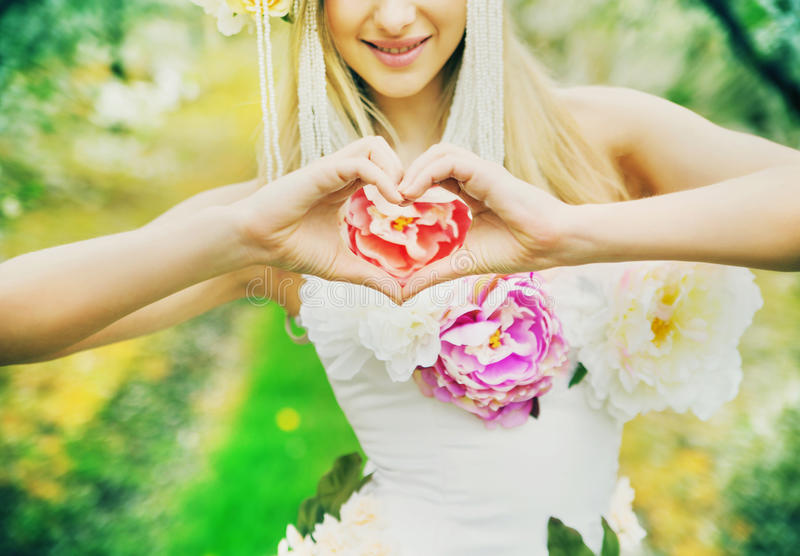 Fresh young lady making the heart sign stock photography