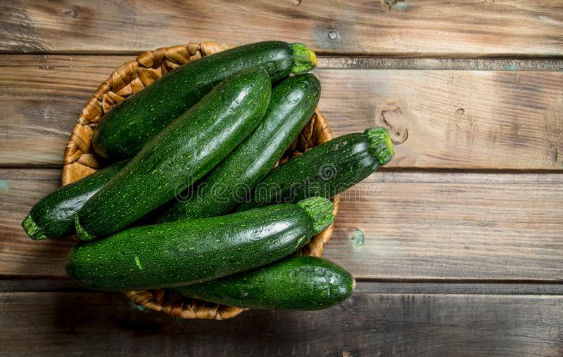 Fresh zucchini in the basket royalty free stock photography