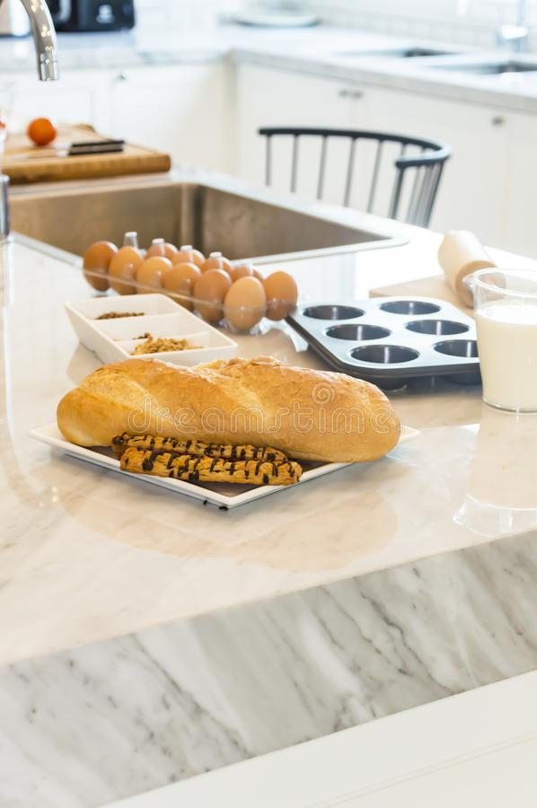 Freshly baked baguette and bread with ingredients for whole grain healthy bread. Freshly baked baguette and bread with ingredients for whole grain healthy bread royalty free stock images