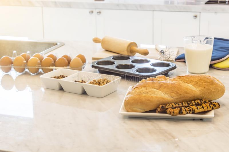 Freshly baked baguette and bread with ingredients for whole grain healthy bread. Freshly baked baguette and bread with ingredients for whole grain healthy bread stock images