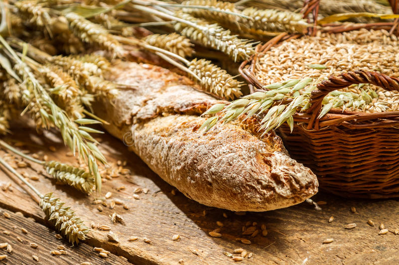 Freshly baked bakery products with cereal grains stock photo