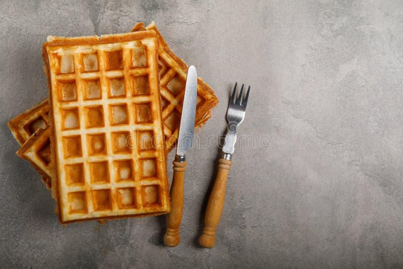 Freshly baked belgium waffles on concrete background. royalty free stock image
