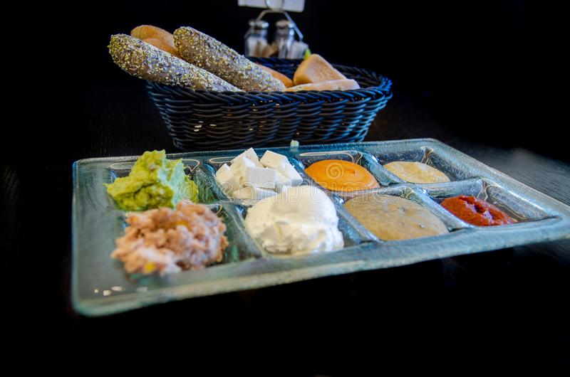 Freshly baked bread and assortment toppings for breakfast at a cafe stock image