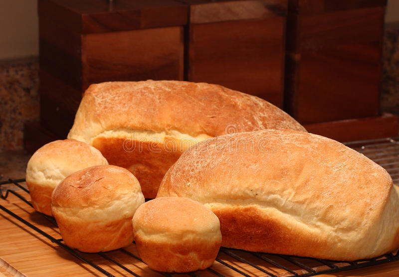 Freshly baked bread and buns stock photo
