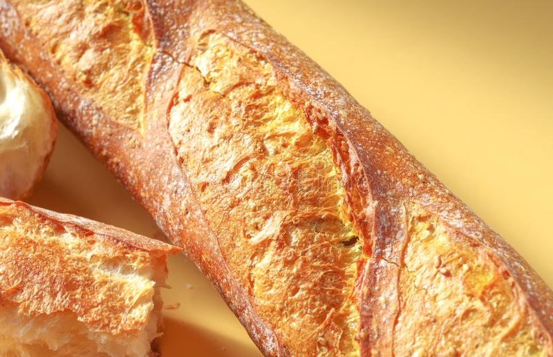 Freshly baked bread. Close up of yellow French baguette with turmeric spice royalty free stock image