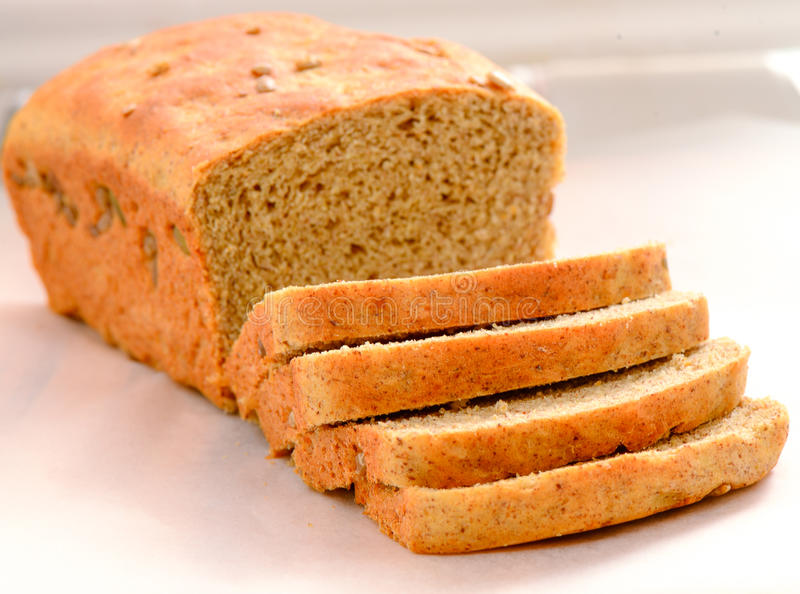 Freshly baked bread cut into loaf stock photos