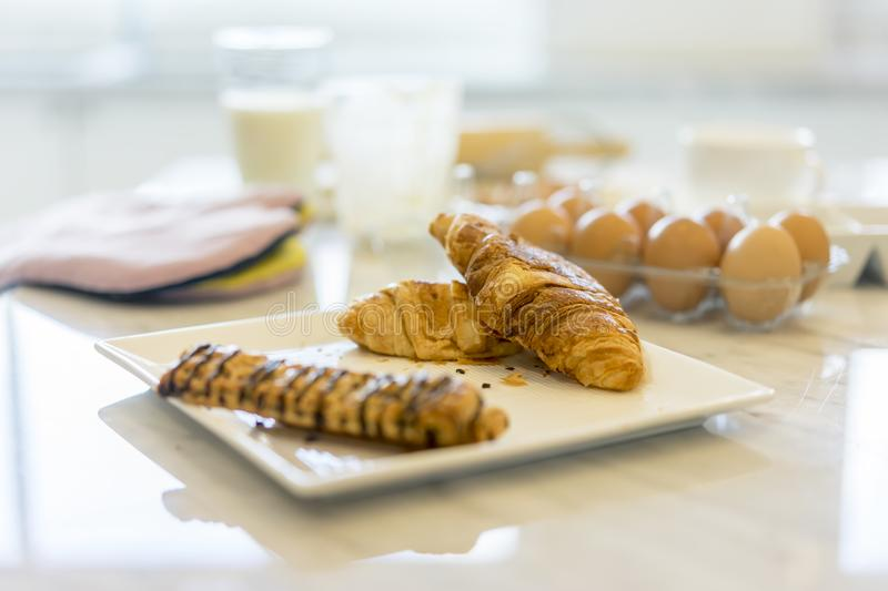 Freshly baked and bread with ingredients for whole grain healthy. Bread,Granola and milk and eggs in the kitchen stock photography