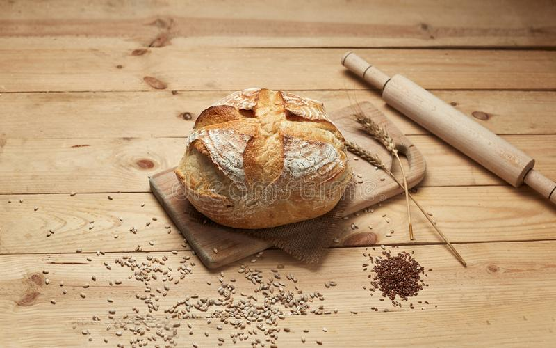 Freshly baked bread. Loaf of bread on wooden background, food closeup. Bread at leaven. Unleavened bread royalty free stock photos