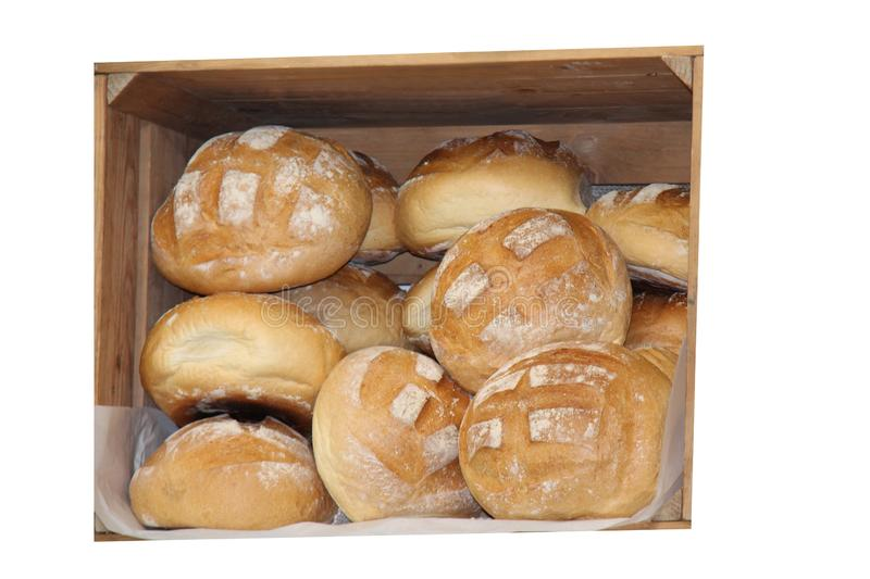 Freshly Baked Bread Loaves. A Wooden Box Displaying Freshly Baked Bread Loaves royalty free stock photo