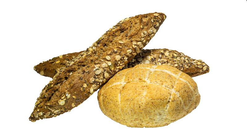 Freshly baked bread with various seeds, close-up pumpkin, flax, oatmeal, millet isolated on a white background stock images