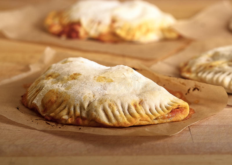 Freshly Baked Calzone. On A Sheet stock photos