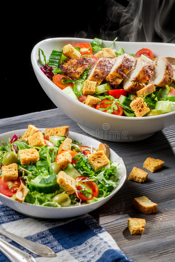 Freshly baked chicken and salad Caesar stock photos