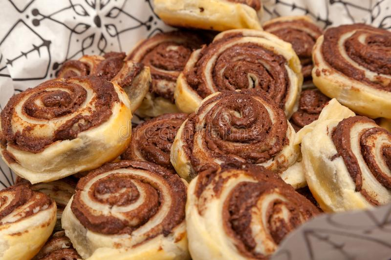 Freshly baked cinnamon buns with chocolate. With decorations stock photography