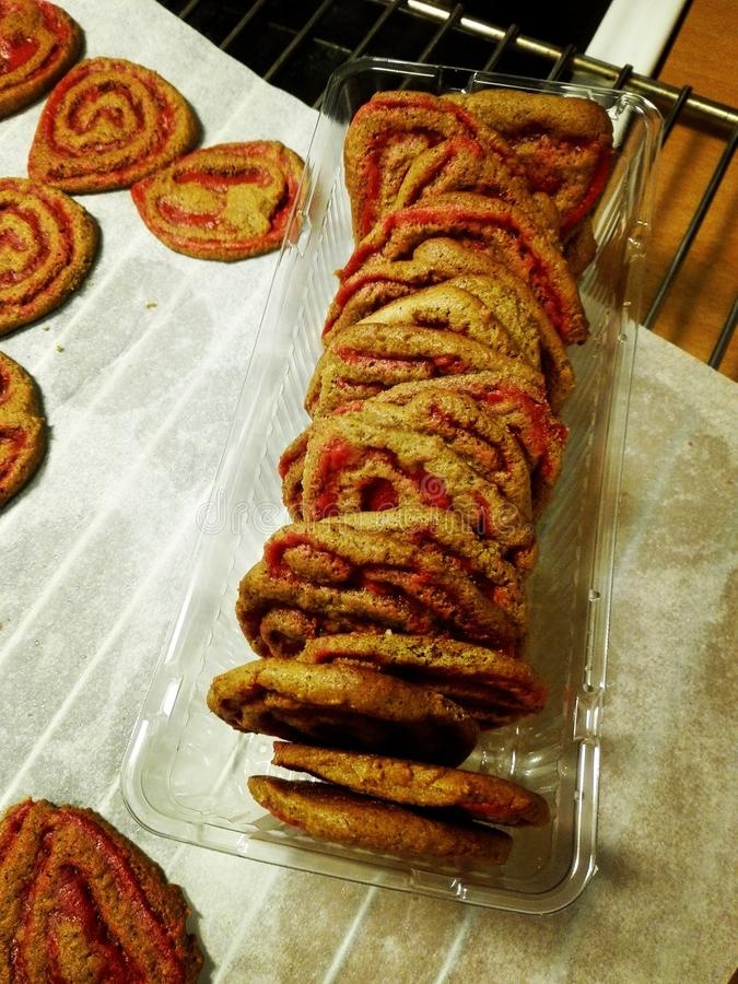 Freshly baked cookies stacked in a cookie container. royalty free stock photos