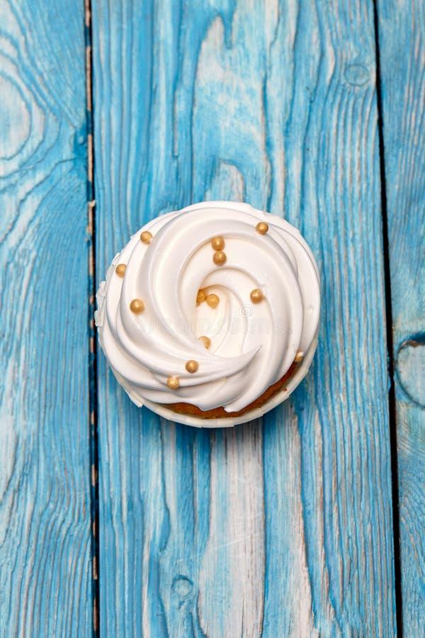 Freshly baked cream cupcake stock photos