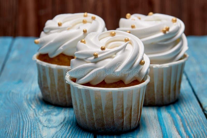 Freshly baked cream cupcake stock images