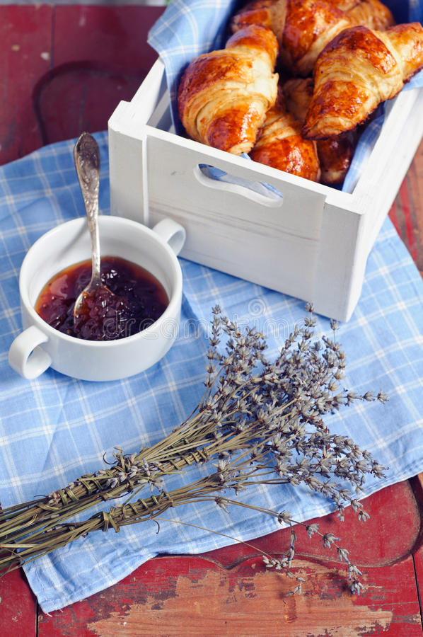 Freshly baked croissants. French morning with croissants and jam stock images