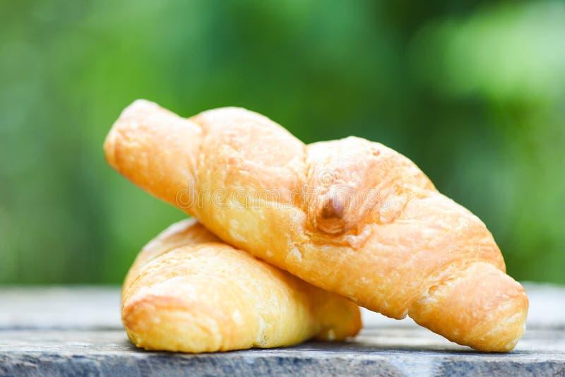 Freshly baked croissants / Bakery bread on wood table homemade breakfast food stock photography