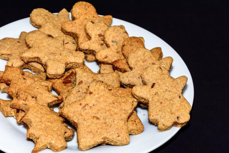 Freshly baked gingerbread in various shapes. Raw vegan stock photos