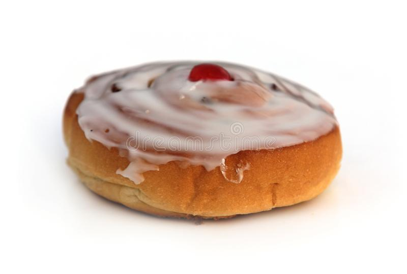 Iced Sweet Roll with Cherry on Top stock images