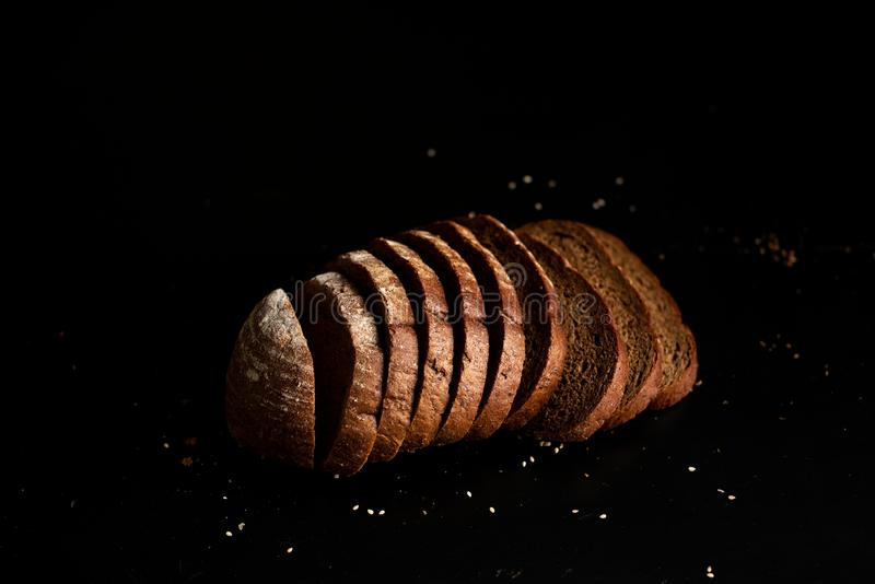 Freshly baked homemade artisan sourdough rye and white flour bread. Sliced. Top view. Close up. Copy space royalty free stock photos