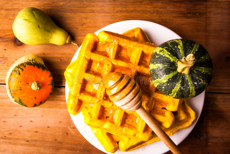 Freshly baked homemade Belgian waffles with pumpkin royalty free stock image