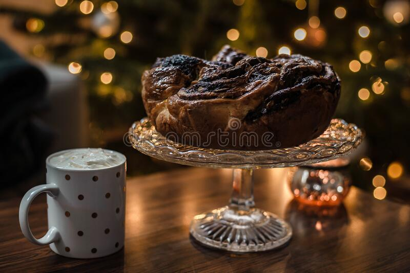 Freshly baked homemade chocolate wreath as perfect Christmas comfort food with hot cocoa and cream. royalty free stock image